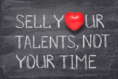 sell your talents, not your time phrase handwritten on chalkboard with red heart symbol instead of O Stok Fotoğraf