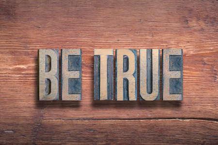 be true phrase combined on vintage varnished wooden surface Stok Fotoğraf