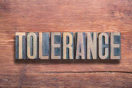tolerance word combined on vintage varnished wooden surface Stok Fotoğraf