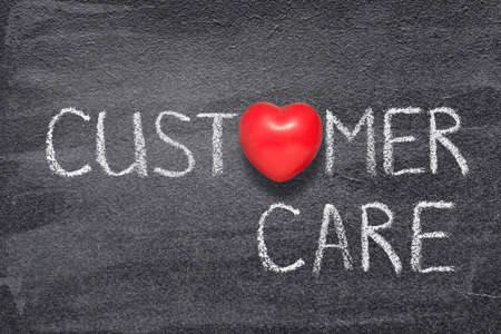 customer care phrase written on chalkboard with red heart symbol