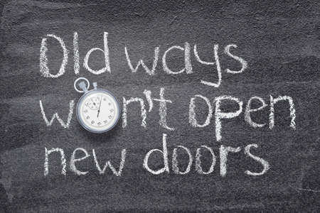 old ways wont open new doors saying written on chalkboard with vintage precise stopwatch Stok Fotoğraf