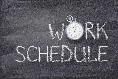 work schedule phrase written on chalkboard with vintage precise stopwatch