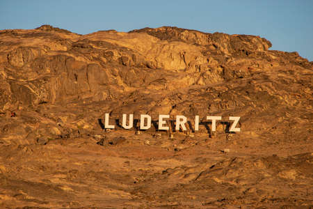 Luderitz town sign on the mountain wall in Namibia