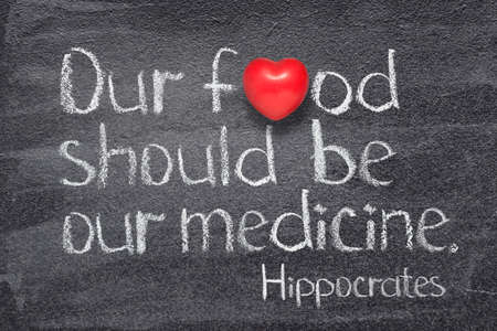 Our food should be our medicine - ancient Greek physician Hippocrates quote written on chalkboard with red heart symbol
