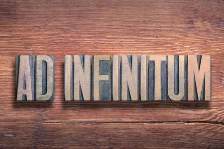ad infinitum ancient Latin saying meaning - to infinity, combined on vintage varnished wooden surface Stok Fotoğraf