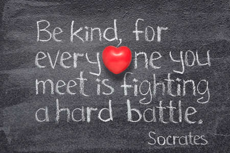 Be kind, for everyone you meet is fighting a hard battle - quote of ancient Greek philosopher Socrates written on chalkboard with red heart symbol instead of O Stok Fotoğraf