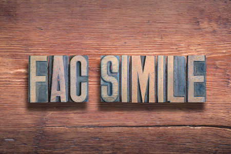 """fac simile ancient Latin saying meaning - make alike; origin of the word """"fax"""", combined on vintage varnished wooden surface Stok Fotoğraf"""
