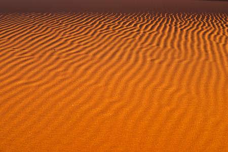 red sand waves pattern in Namibia desert Stok Fotoğraf