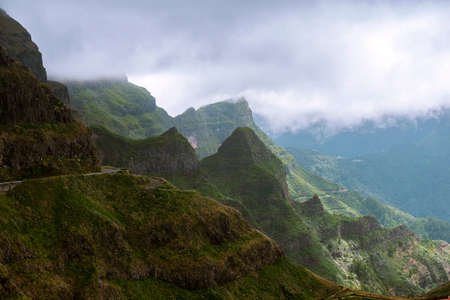 scenic green mountains of Madeira Island with rainy clouds approaching Stok Fotoğraf