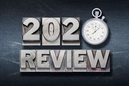 review 2020 phrase made from metallic letterpress with stopwatch Stok Fotoğraf