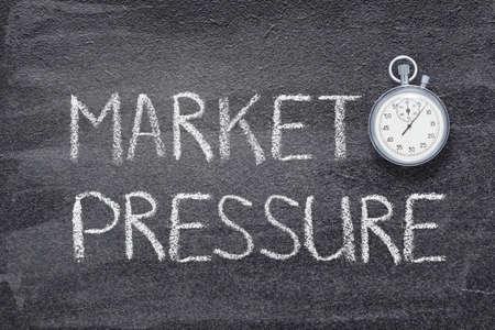 market pressure phrase written on chalkboard with vintage precise stopwatch