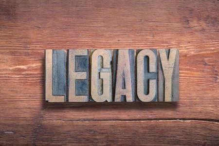legacy word combined on vintage varnished wooden surface Stok Fotoğraf