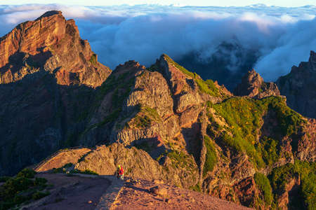 atop of Madeira Island with tourists walking toward Pico Ruivo by hiking trail Stok Fotoğraf