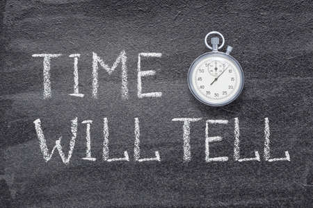 time will tell saying written on chalkboard with vintage precise stopwatch Stok Fotoğraf