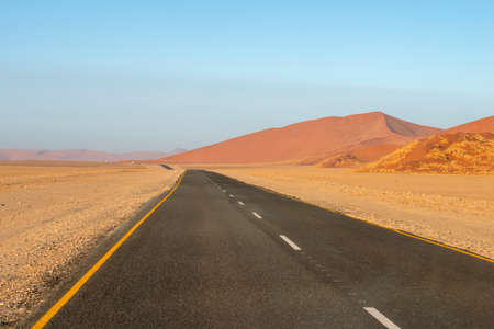 straight highway in famous Sossusvlei valley in Namibia Stok Fotoğraf