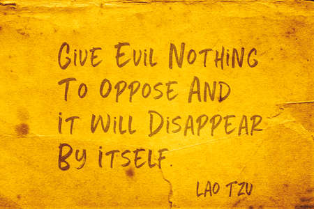 Give evil nothing to oppose and it will disappear by itself - ancient Chinese philosopher Lao Tzu quote printed on grunge yellow paper