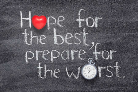 Hope for the best, prepare for the worst proverb written on chalkboard with red heart symbol