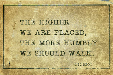 The higher we are placed, the more humbly we should walk - ancient Roman philosopher Cicero quote printed on grunge vintage cardboard