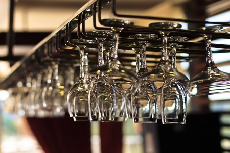 Glasses for wine above a bar rack Stock Photo - 16951014