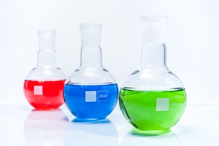 Set of three spherical flat bottomed temperature resistant flasks with color liquid photo