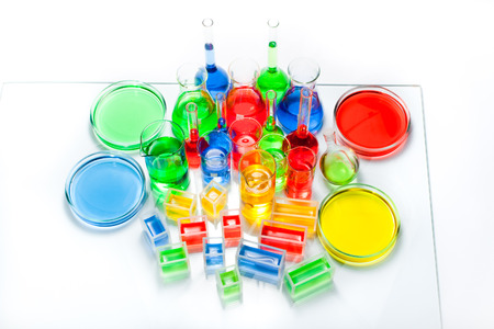 Set of laboratory glassware of different capacity and shapes with color liquid photo