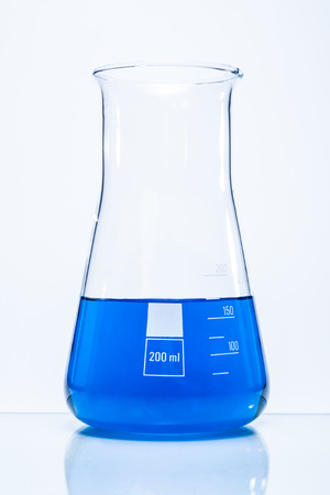 resistant: Conical temperature resistant flask with blue liquid Stock Photo