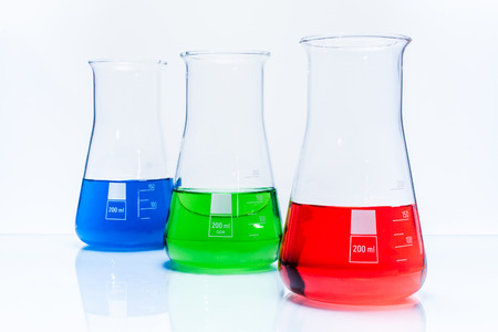 Set of three conical temperature resistant flasks with color liquid photo