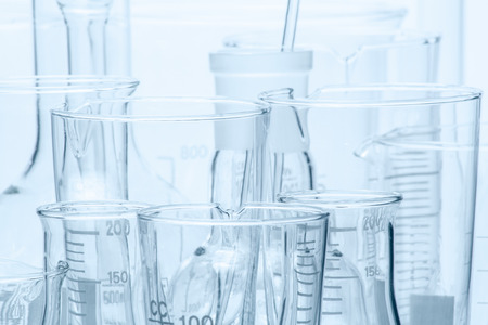 medicine background: Set of laboratory glassware of different capacity and shapes
