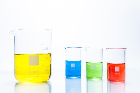 cylindrical: Set of temperature resistant cylindrical beakers with color liquid Stock Photo