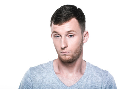 dissapointed: Sad and unhappy young man