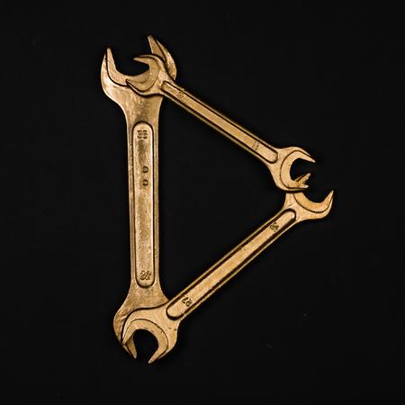 Letter D. Alphabet made of golden repair tools. Creative font