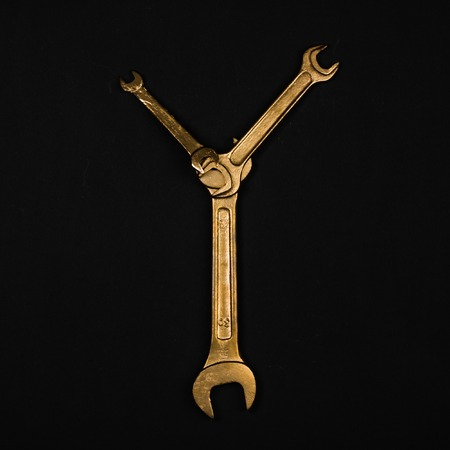 Letter Y. Alphabet made of golden repair tools. Creative font