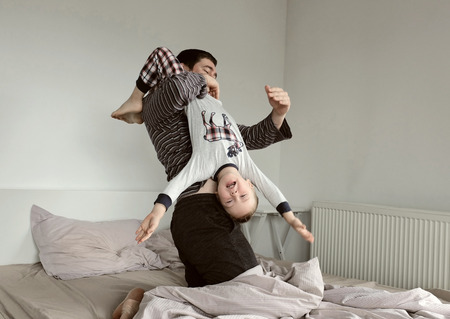 Father and son fun on the bed