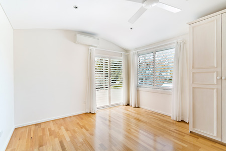skirting: Empty room, with huge windows and a gorgeous view. Stock Photo