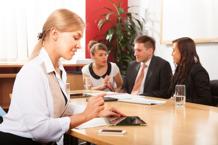 training group: Portrait of beautiful woman on the background of business people