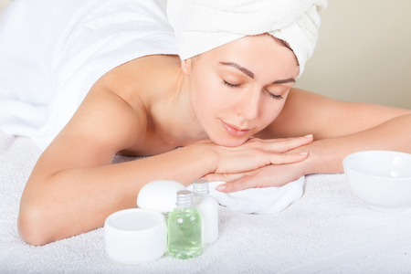 white day: Closeup portrait of attractive gentle female enjoying day spa in luxury beauty salon, alternative medicine, harmony and inner peace concept Stock Photo