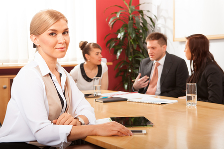 real leader: Portrait of beautiful woman on the background of business people