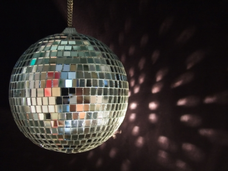 miror: shiny disco ball with reflections on black background
