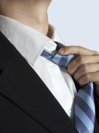 strip shirt: shirt tie and suit details Stock Photo