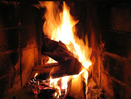 burning wood in fireplace photo
