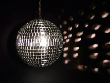 miror: shiny shiny disco ball with reflected light at background