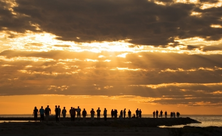 group of people enjoying the sunset at pirita beach, tallinn