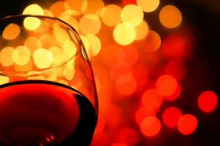 close-up of wineglass with copyspace and abstract lights background Stock Photo - 691169