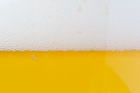 pilsner: beer bubbles. glass of beer - close up shot. Stock Photo