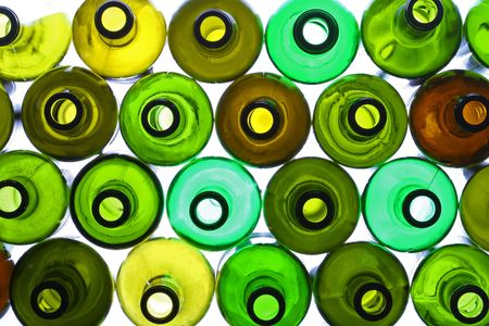 colored bottle: stack of assorted empty wine bottles backlited Stock Photo