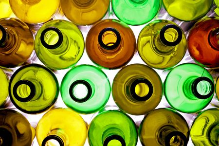 stack of assorted empty wine bottles backlited photo
