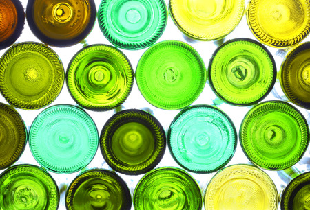 green glass bottle: variety of empty wine bottles backlited