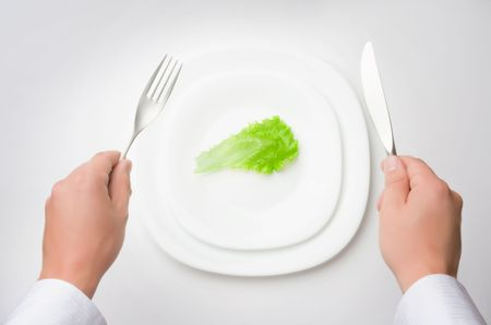 small plate: eat less! concept of healthy eating  dieting Stock Photo