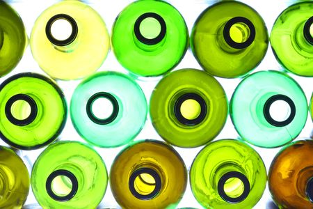 colored bottle: close-up of stack of various wine bottles, backlited Stock Photo