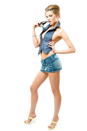 attractive girl posing in jeans outfit, isolated over white photo